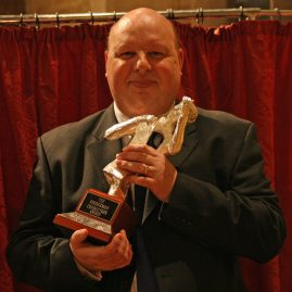 Chris Jeans with the 2016 Blackpool winning conductor's trophy